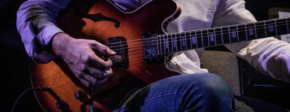 man plays guitar